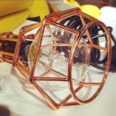 Smaller geometric copper wire light pendant. A few of these hung above a kitchen breakfast bar would look awesome