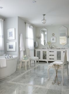 bathroom; grey, white; no rugs - wonder if it's in the South or radiant heat flooring