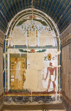 https://flic.kr/p/zibQrN | Djeser-Djeseru: Upper Anubis Shrine | Djeser-Djeseru, Temple of Queen Hatshepsut at  Deir el-Bahari Upper Anubis Shrine, northern wall of the first room On the wall Hatshepsut, followed by her father, standing on the right side before the jmj-wt fetish, which is depicted in a shrine on the left side of the scene. (the images of Hatshepsut and the fetish had been destroyed) The scene is completely superimposed by the sign of  heaven and a winged solar disc with two…