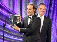 MAY 14, 2015 Honoree Alexandre Desplat (L) accepts the BMI Icon Award from BMI President and CEO Mike O'Neil during the 2015 BMI Film & Television Awards at the Beverly Wilshire Hotel on May 13, 2015 in Beverly Hills, California. (Photo by Frazer Harrison/Getty Images for BMI)