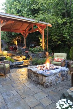 dry-laid paver manufactured by Belgard.  firepit itself is a natural stone mortar-set with eagle mountain stone - love the stone steps down to the firepit area
