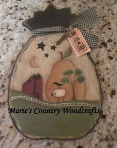 Hand painted wood pineapple with a prim scene
