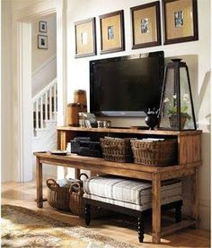 This may work in the guest room. Places to put bottles of water, snacks and mints, and doubles as an entertainment center.