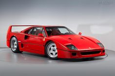 The Ferrari F40 is a mid-engine, rear-wheel drive, two-door coupé sports car produced by Ferrari fro...
