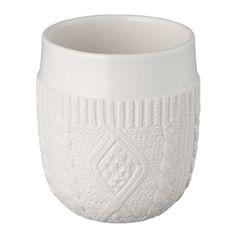Termo kopp i keramikk med avtrykk av strikk.