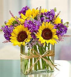 Beautiful simple flower arrangement would be so easy to recreate using glass block as vase and cuttings from gardens.