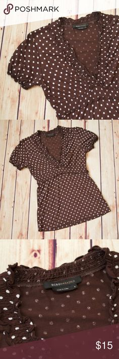 BCBGMaxAzria Small Chocolate Polka Dot V-Neck BCBGMAXAZRIA Beautiful chocolate polka dot top with v-neck, size small. Excellent condition! Subtle ruffles around neckline, under bust, and on edge of gathered sleeves. Adorable details! BCBGMaxAzria Tops Blouses