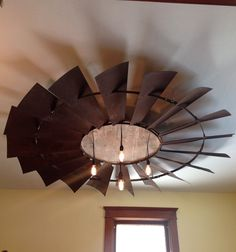 This is an antique windmill that is 8 ft across with a barn board center and Edison light bulbs we hung from our dining room ceiling. Transitional Fireplaces, Transitional Chandeliers, Transitional Living Rooms, Transitional Lighting, Transitional Kitchen, Transitional Style, Western Decor, Country Decor, Rustic Decor