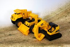 Toy State CAT Tough Tracks, Officially licensed by CAT NA Includes dump truck, bull dozer and back-hoe Great for the beach A great addition to any sandbox No batteries required Little Boy Toys, Little Boys, Buy Toys, Toys Shop, Toddler Toys, Kids Toys, Construction Toys For Boys, Caterpillar Toys, Beach Play