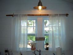 a curtain rod from a bamboo rod and deer antlers - Jane Coslick Cottages : Tybee