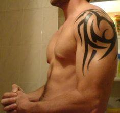 Tribal Shoulder Tattoo... I didn't notice the tattoo... LOL
