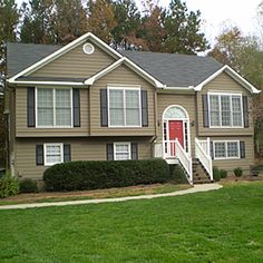 Yellow House Red Door Black Shutters tan house, black shutters, red door | porches + patios / home