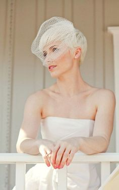 A birdcage veil looks great with a pixie cut.