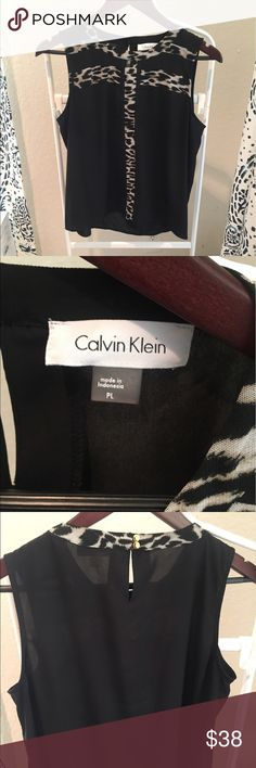 Calvin Klein Animal Print Stripe Shell Size is technically a petite large but it runs small so I sized it for search purposes as a petite medium. Great condition, only worn 2-3 times. Offers accepted. Calvin Klein Tops
