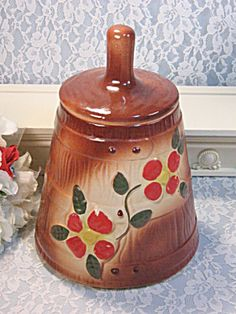 Vintage McCoy Pottery Brown Red Flower Butter Churn Cookie Jar. Click on the image for more information.