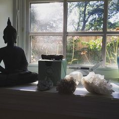 My Buddha handing out on the window to keep the crystals company as they charge up! So grateful for the strong full-moon. Angel card reading is live at 10 est tonight on Periscope. Follow me @haleynight.
