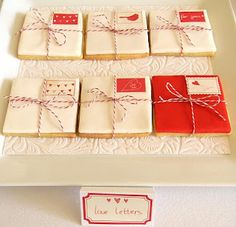 """""""Love Note"""" cookies wrapped with baker's twine and with edible postage stamps -"""