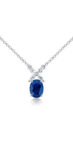 This delicate sapphire and diamond pendant features four matching marquise-cut diamonds accenting the center oval blue sapphire | #Valentines