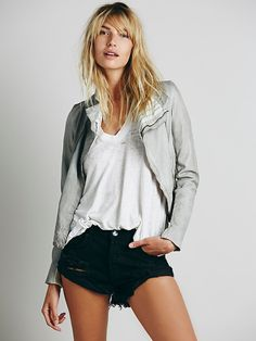 Bandit Denim Cutoffs | Distressed denim cutoffs with shred detailing and frayed edges.  Five-pocket styling with a button fly.  Asymmetrical hem.    *By One Teaspoon