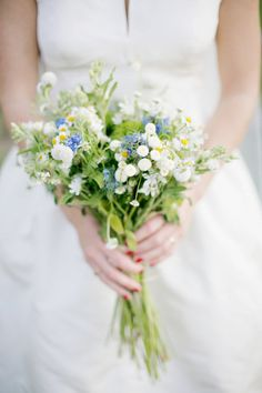 Simple, wildflower bouquet/ good colors. bridesmaids. something like this for vases/bottles