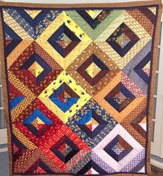 """This is more """"planned"""" than the strip piecing I do, but I like it for a change. Nice colors, too. Necktie Quilt, Shirt Quilts, Old Ties, Tie Crafts, String Quilts, Mens Silk Ties, Quilting Projects, Quilting Ideas, Sewing Projects"""