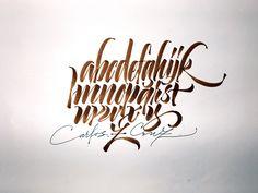 Brush condensed alphabet.