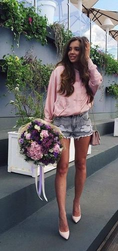 Girly fashion look | pink sweater   ripped denim shorts
