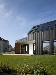 """Private house in Verrières-Le-Buisson (France) by Nomade Architectes """"Air et Lumière VELUX"""" Model Home 2020 - Photographer: Adam Mørk #Architecture #Facade #Project #PrivateHouse #AnthraZinc #Zinc #VMZINC"""