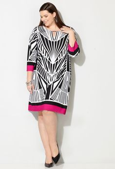 Shop flattering geometric dresses in trendy black and white like our plus size Abstract Geo Metal Bar Dress available online at avenue.com.