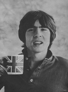 Davy Jones of the Monkees raises a toast.  O, how I loved him when I was little!