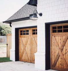 Home Renovation Garage wood rustic farmhouse Garage doors, white siding, black roof Faux Wood Garage Door Diy, Modern Garage Doors, Wood Garage Doors, Garage Door Design, Black Garage Doors, Black Doors, Garage Roof, Black Shutters, Front Doors