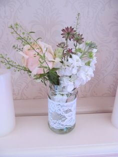 jar decorated with lace with blooms of sweet avalanche rose, scented white stock, thaspi and astrantia