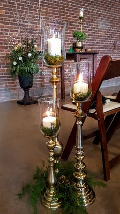 Tall Gold Candlesticks with fresh greens  Wedding Ceremony Aisle Decor at #Paikka