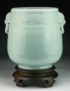 """A Chinese Antique Celadon Glazed Porcelain Jar of Qing Dynasty, presented on a wood stand; Size: H: 9-3/4""""; (overall) H: 12-1/4"""""""