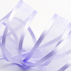 Add a soft hint of colour to your favours, decor and wedding with this LilacSatin Edge Organza Ribbon.