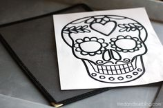 Dia De Los Muertos Free Printable from Tried & True. So cute! I want to print this on transparency paper, then use it as a stencil to paint on fabric for a DIY Banner, or bag, or shirt. The possibilities are endless!