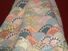A pinner said, I saw this quilt on top of a cabinet in a coffee shop in Paducah. I had made a New York Beauty, but this was the first time I had ever seen this pattern..