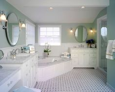 Corner tub, with vanities on either side.  Like the tile