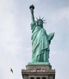 the statue of liberty with a message to refugees