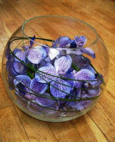 violet vanda orchids with whipped grasses fake it