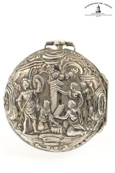 "Simon Descharmes, London, 49 mm, 144 g, circa 1740  A rare pair-cased verge pocket watch with ""repoussé"" decoration ""The Continence of Scipio"" and enamel scene ""The Passion of Christ"" on the dial Case: outer case silver, Inner case silver. Dial: silver/enamel. Movm.: full plate movement, chain/fusee, three-arm steel balance"