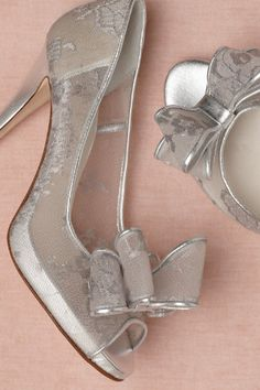"""Mercury Peep-Toes from BHLDN Pert bows perch over glittering metallic lace, sculpted into a pair of sheer and chic stilettos by Something Bleu. 4"""" leather-wrapped heel. Nylon and leather upper; leather sole. Handmade in Italy."""