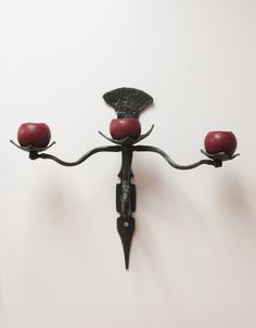 """""""Bringer of Light"""" wall sconce forged by Kriev of Pike Lake Forge using traditional joinery methods."""