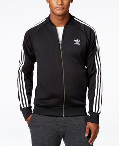 adidas improves tradition with the update streetwise look of its classic Superstar track jacket. This versatile essential lets you warm up in comfort or gives you great casual style on the go. | Polye