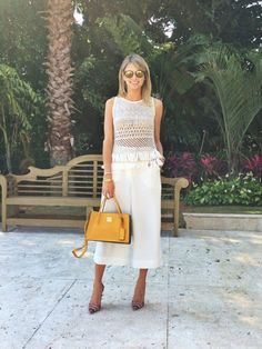 Spring / Summer - street chic style - beach style - casual style - cream sleeveless paneled fishnet fringe top + cream culottes + mustard leather bag + colorful striped stilettos + mirror sunglasses