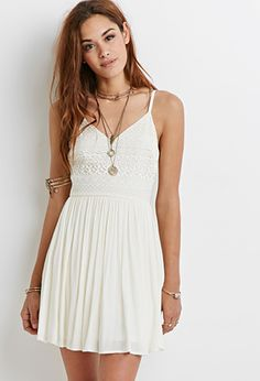 Crochet Cami Dress:With a crocheted bodice and crinkled woven skirt, this cami dress is romantic and airy. While it's pretty and polished enough for a dinner date, go ahead and rock it at the next big festival.
