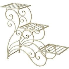 Display your favorite greenery, blooms, and herbs with this charming iron plant stand, showcasing a white finish and scrolling design. Product: Plant stand Construction Material: IronColor: CreamFeatures: Scrolling design Three tiers Dimensions: H x W x D Joss And Main, Peacock Plant, Tiered Planter, Wrought Iron Decor, Iron Plant, Iron Furniture, Flower Stands, Iron Work, Interior Design Living Room