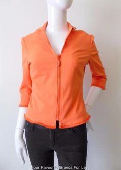 Harry-Who-Jacket-Size-8-US-4-Orange-Zip-Front-Made-In-Australia Harry Who size 8 (US 4) orange zip front jacket. The jacket has an exposed zip and three quarter length sleeves. The hemline and cuffs feature a one sided decorative zip. It is fully lined and has stretch. Made in Australia