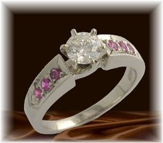 """""""Bridal Blush,"""" - custom-made GB Jewelers ring with a Diamond center and Pink Sappjite trim"""