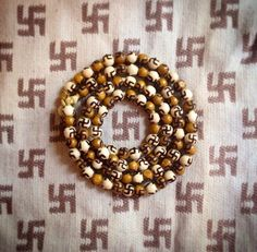swastika prayer bead mala necklace for meditation 108 beads buddhism hinduism germanic occult mystic tool by DesertRoseArts on Etsy https://www.etsy.com/uk/listing/177602521/swastika-prayer-bead-mala-necklace-for